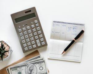 image of money, calculator and checkbook